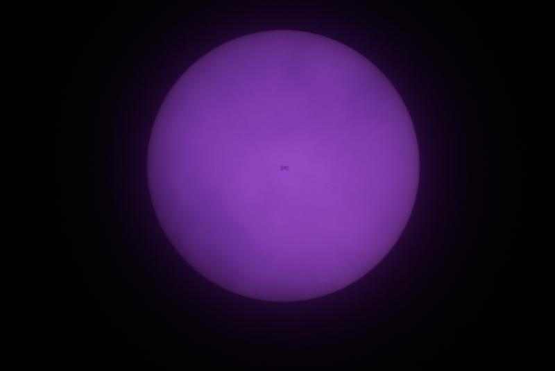 ISS transit across the Sun - slightly cloudy blocking view